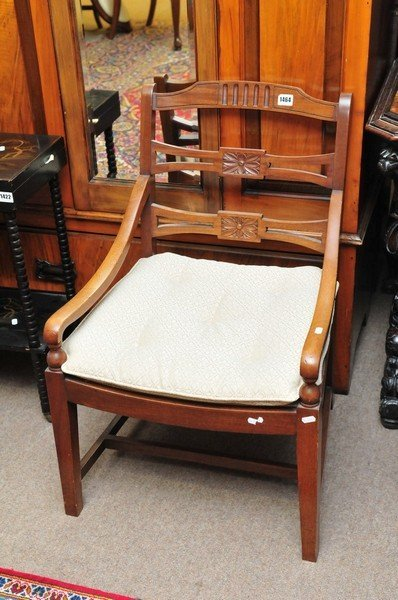 An open arm occasional chair with slat back and detacha
