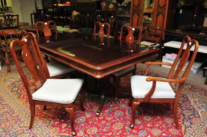 A large reproduction dining table on twin pedestal with