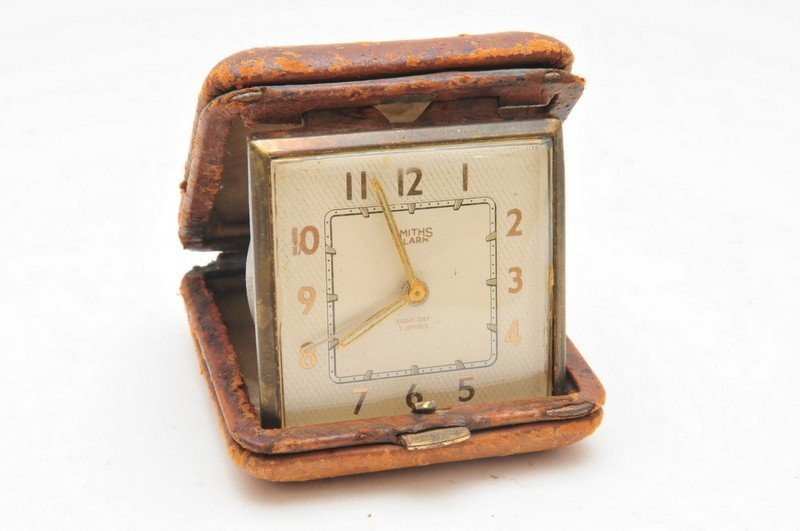 A Smiths travelling clock, the square dial with Arabic