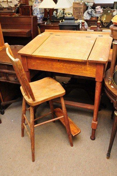 An oak clerk's desk having hinged lids and folding flap