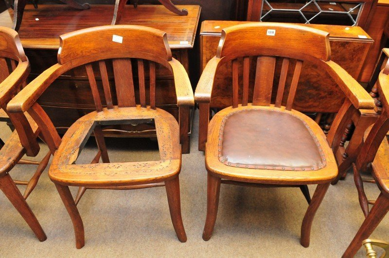 A set of seven oak office type chairs