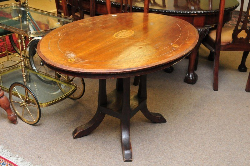 A walnut loo table with oval top on a later base.