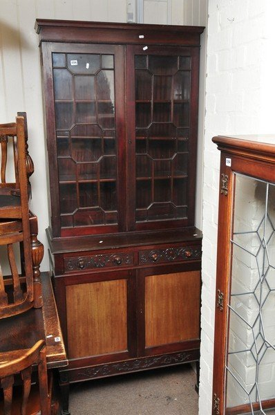 An Edwardian mahogany glass fronted bookcase, lower pan