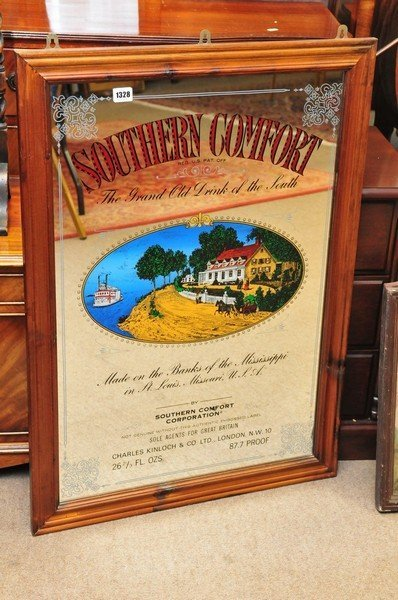 A large framed advertising mirror of Southern Comfort