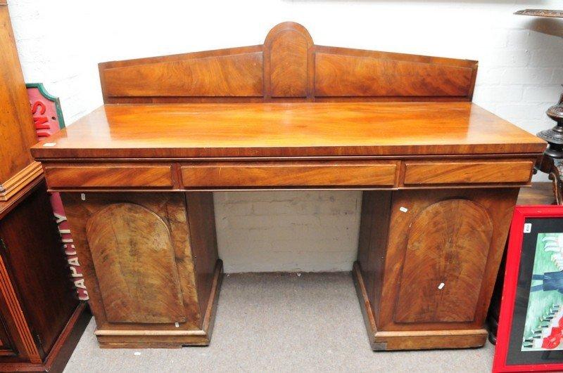 A Victorian mahogany pedestal sideboard, the raised bac