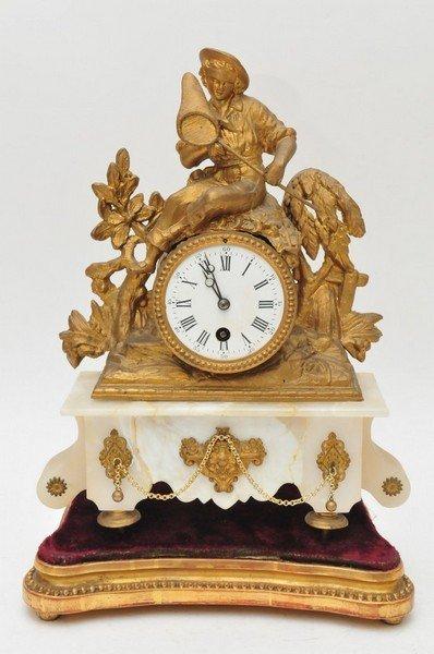 A French spelter gilt mantle clock on gilt base