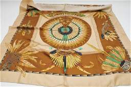 A Hermes Brazil silk scarf with feather motifs marke