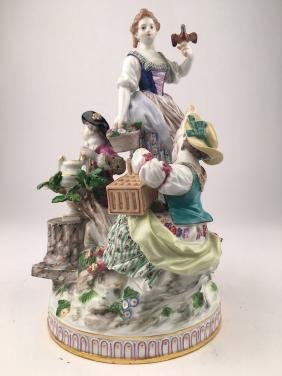 Meissen figurine of two women and one man.