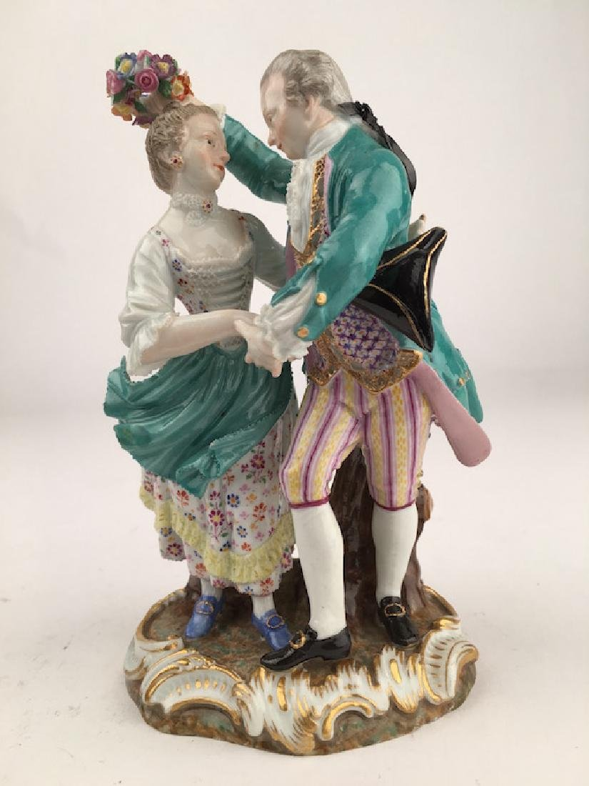 Meissen figurine of a man and lady dancing.