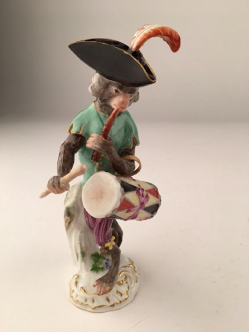 Meissen monkey band member playing a drum.