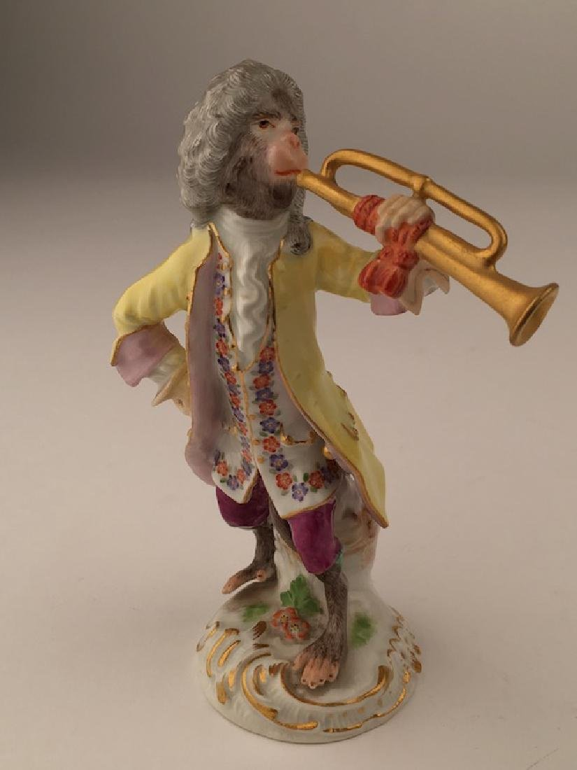 Meissen monkey band member playing a trumbone.
