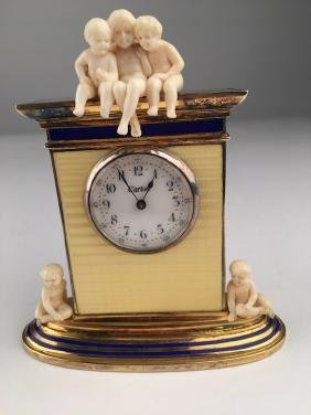Cartier figural desk clock with three young children on