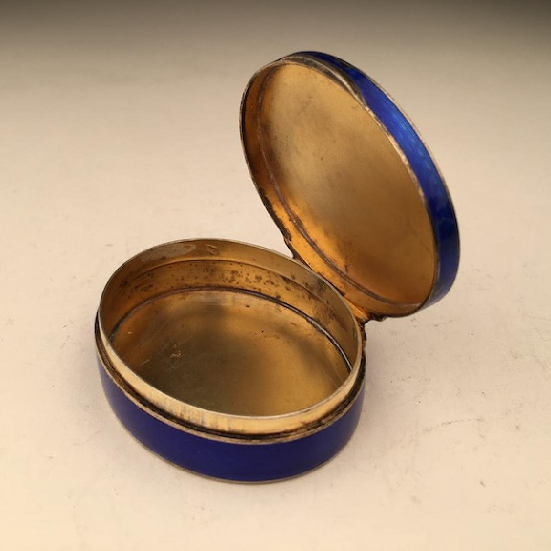 Silver and colbalt blue oval box. - 2