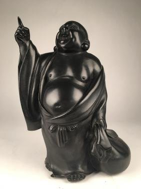 A bronze figure of a Hotei, God of Happiness.