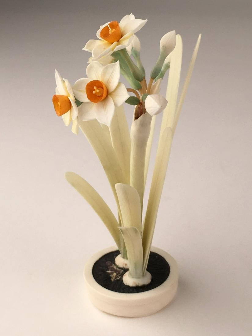 A carving of two flowering flowers in a small pot. - 6