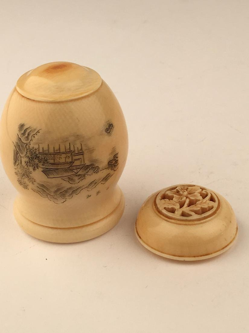 A carved cricket jar with cap. SIgned on the side.