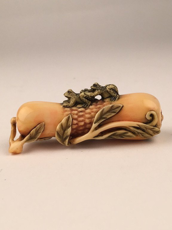 Carved netsuke figure of two small frogs on a stalk