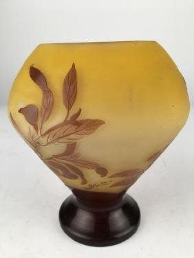 Galle cameo vase with dark and light brown leaves on a