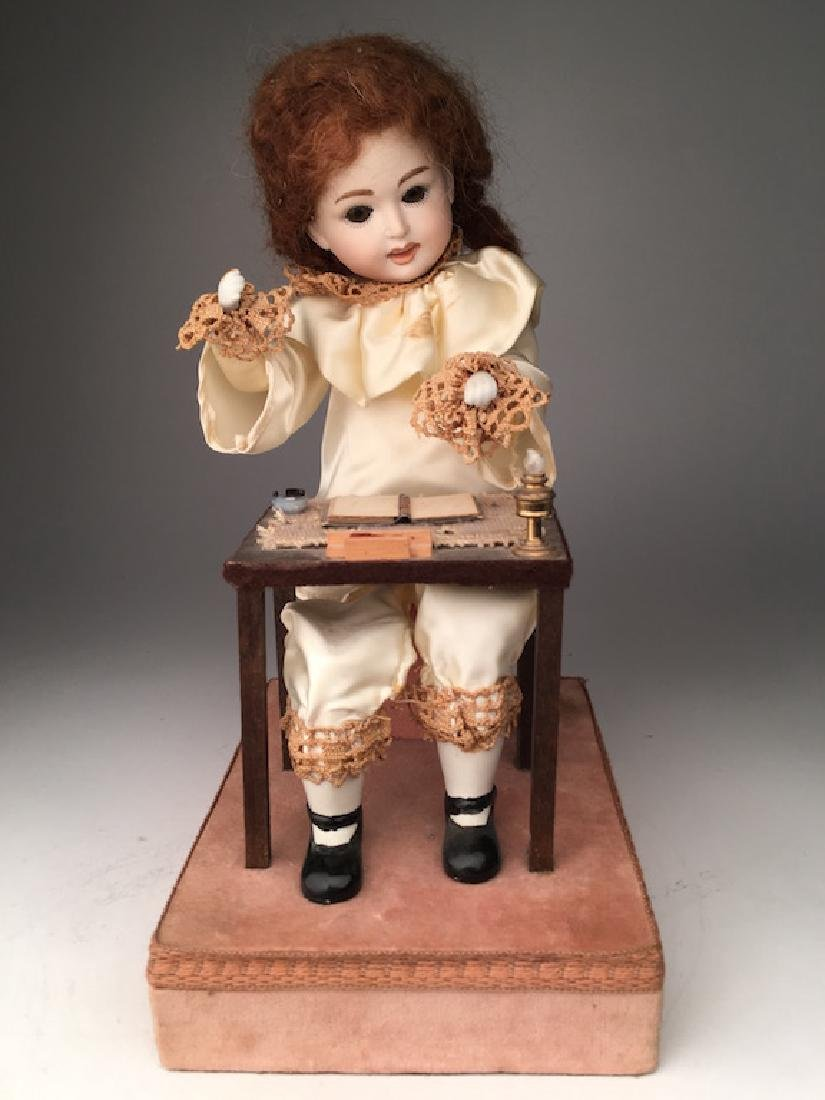 Musical Automaton of a clown playing an accordian.