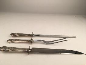 Three piece carving set with sterling silver handles.