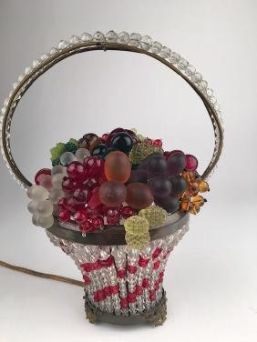 Antique beaded and glass handled basket.