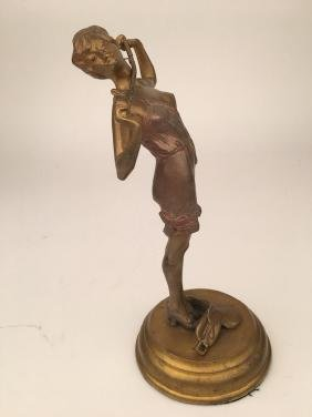 Bronze figure of a semi nude woman with a ridding crop