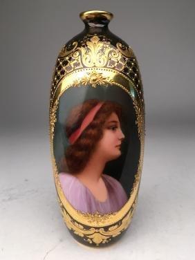 Royal Vienna portrait bud vase with gold enamel on a