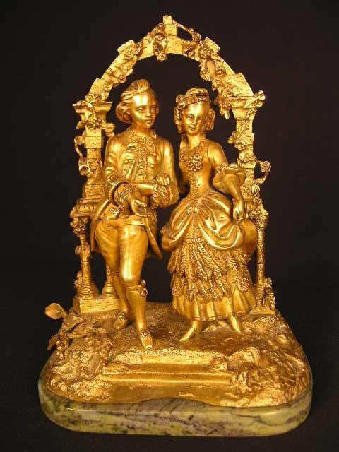 "2039:  ""GOLD GILT BRONZE FIGURINE OF AN  ELEGANT COUPLE"