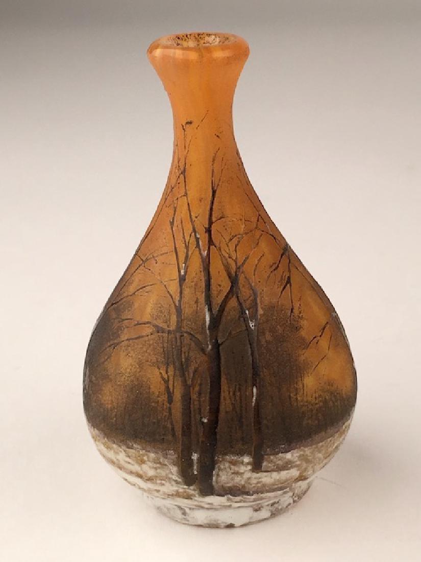 Minature Daum vase of a winter scene.