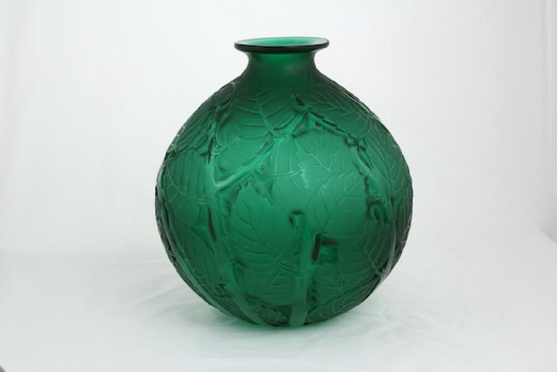 """Rene Lalique """"Milan"""" green glass vase."""