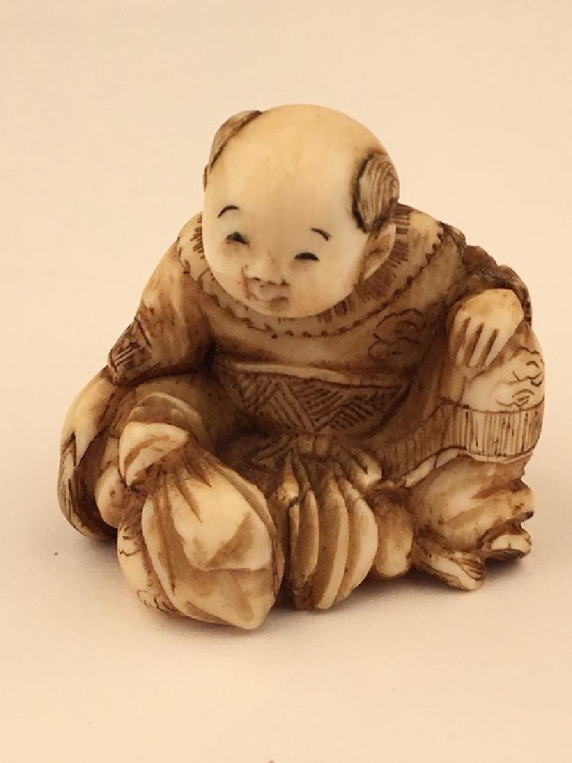Antique carved Netsuke figure of a sitting person with