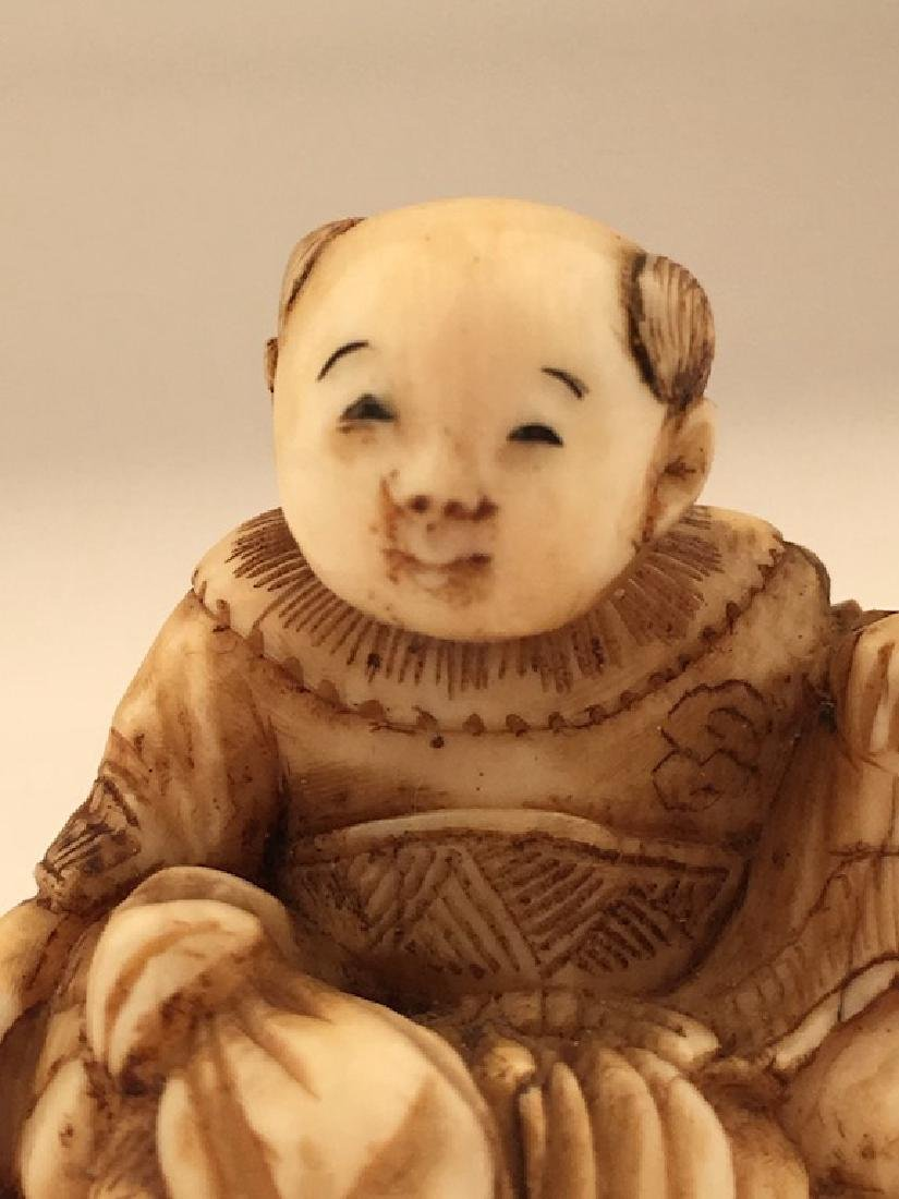 Antique carved Netsuke figure of a sitting person with - 2