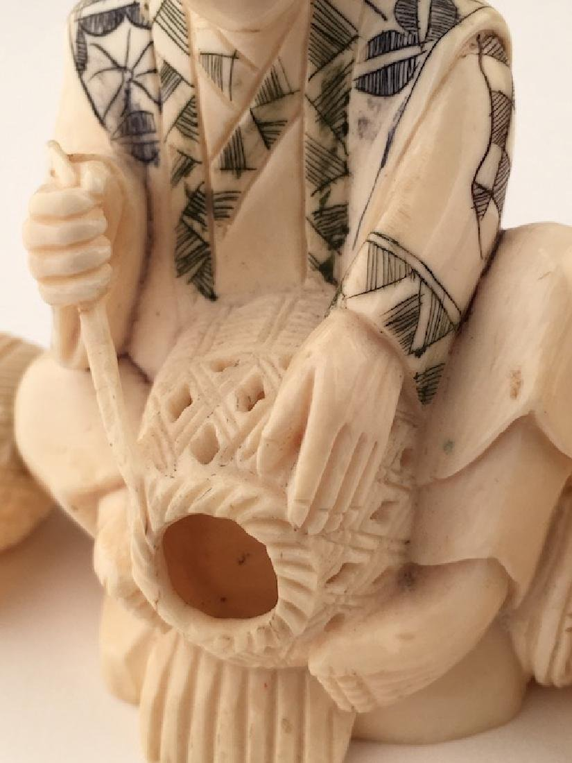 Carved Okimono figure seated and making baskets. SIgned - 3