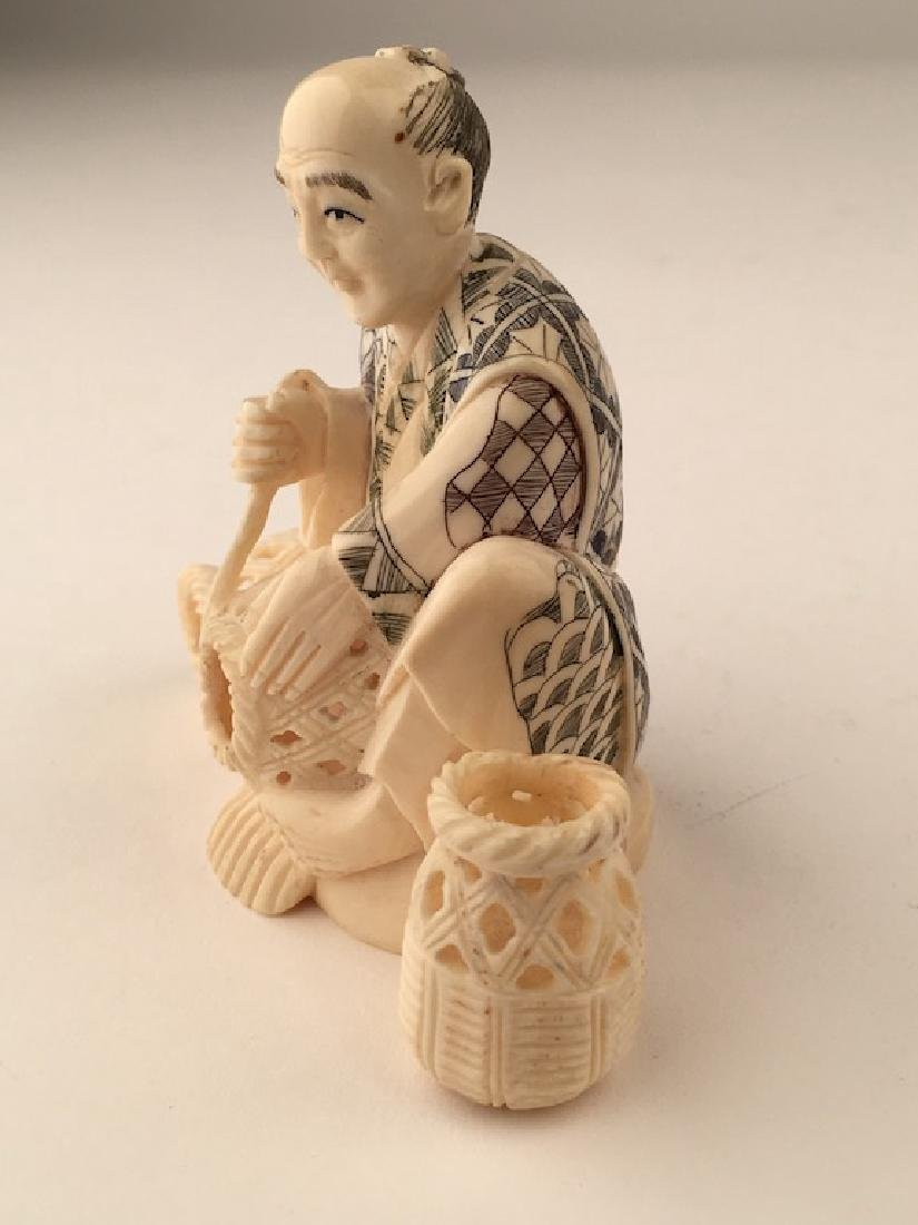 Carved Okimono figure seated and making baskets. SIgned - 4