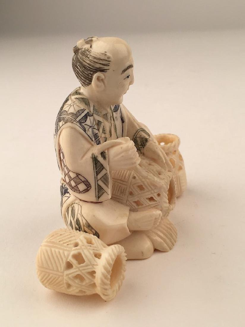 Carved Okimono figure seated and making baskets. SIgned - 6