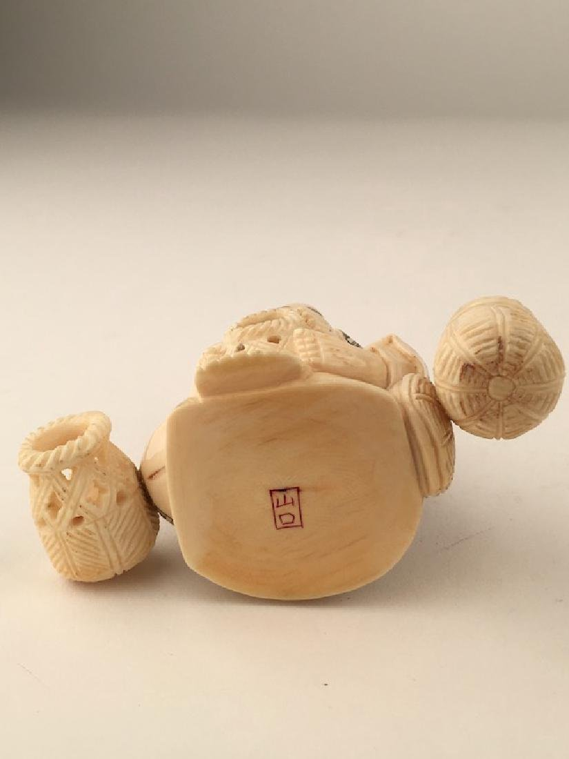 Carved Okimono figure seated and making baskets. SIgned - 7