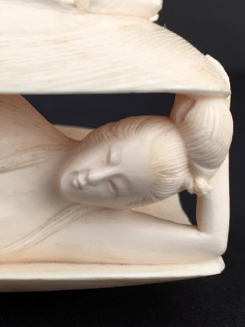 Carved nude lady laying in a large clam shell. - 2