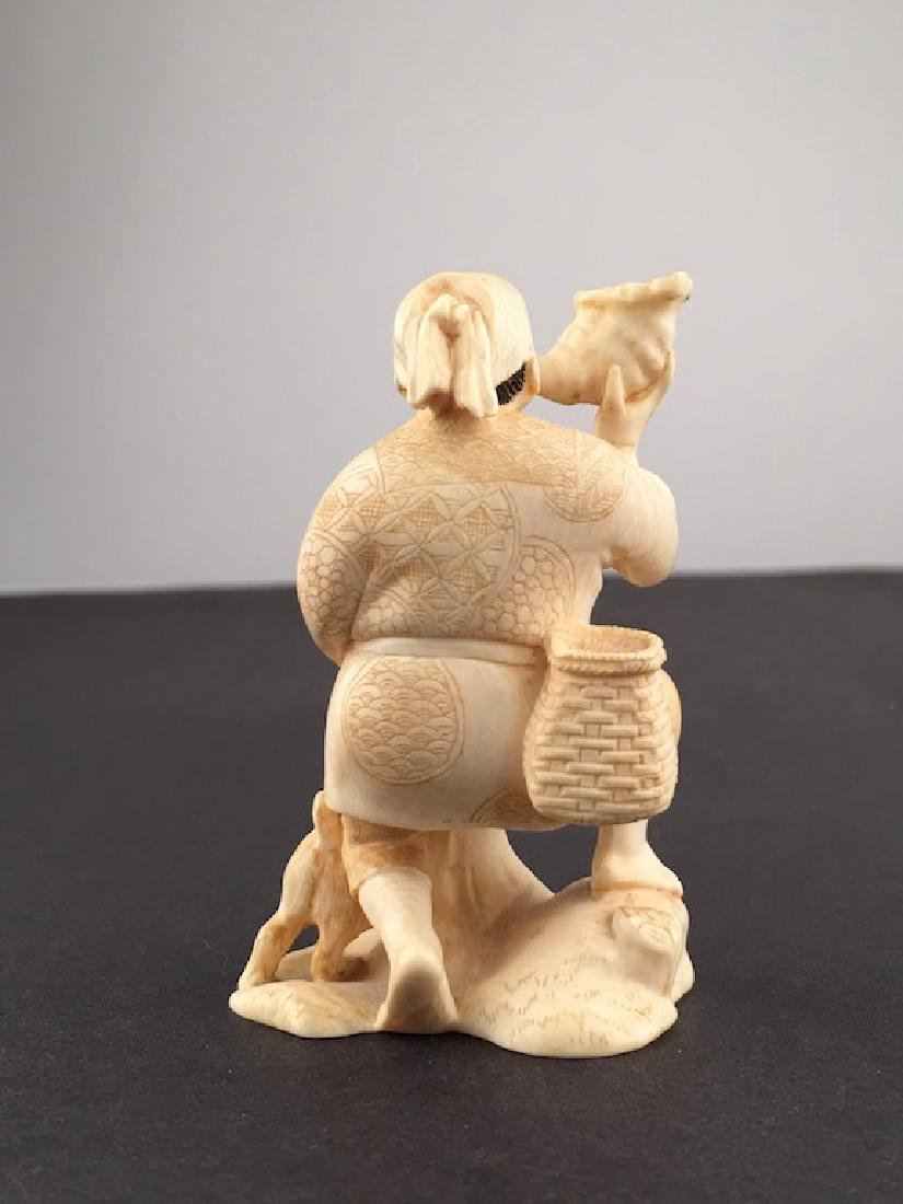 A carved man man wearing a sack and blowing into a - 3