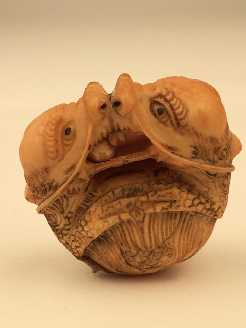 Antique carved Netsuke figure of two animals biting at