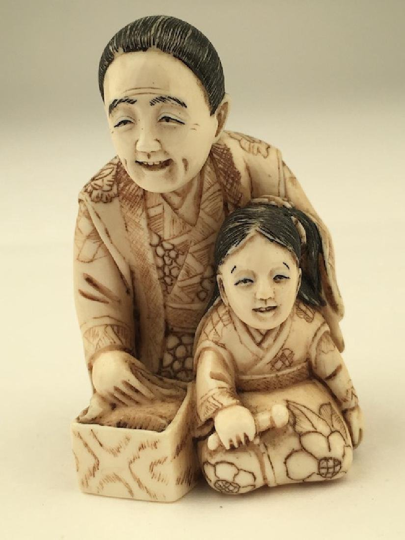 Antique carved Netsuke figure of a mother and child