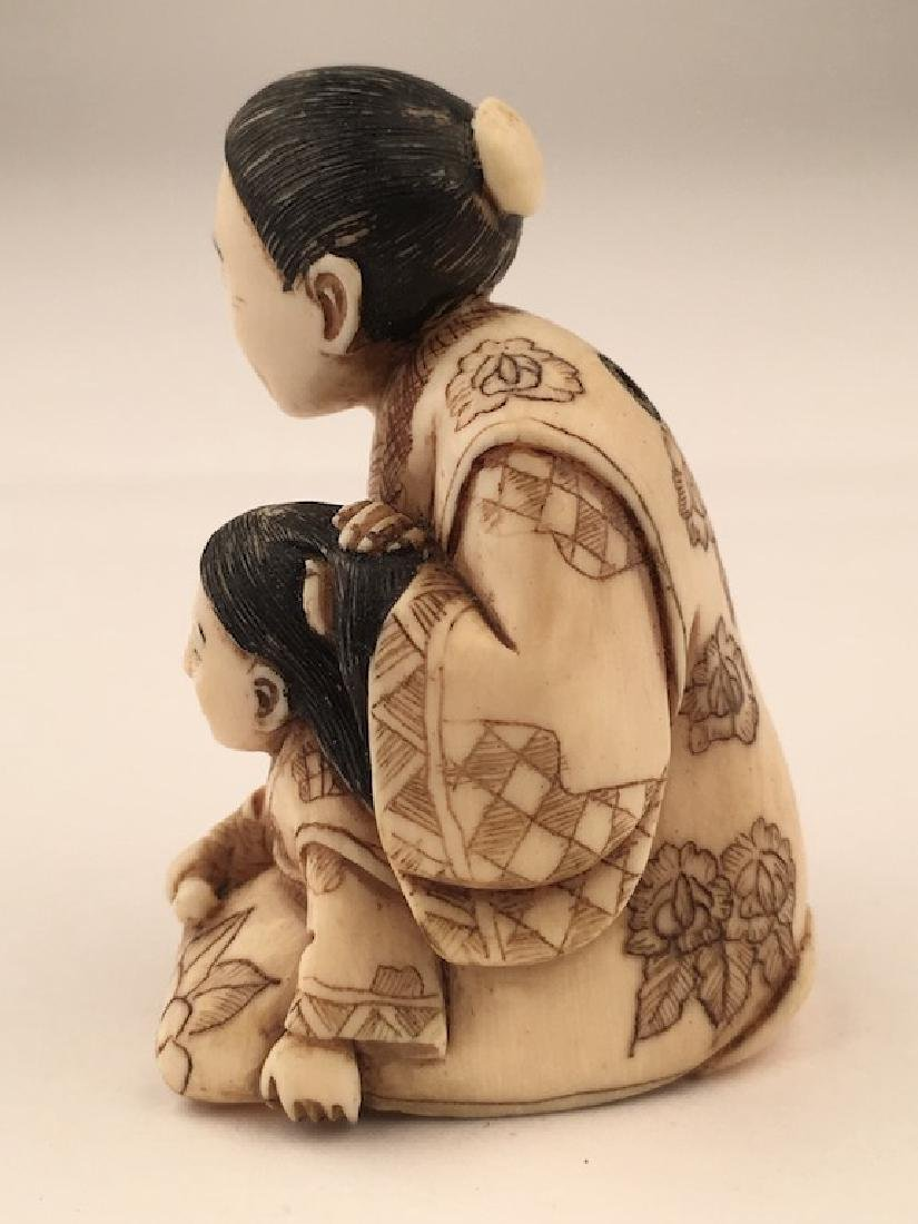 Antique carved Netsuke figure of a mother and child - 2