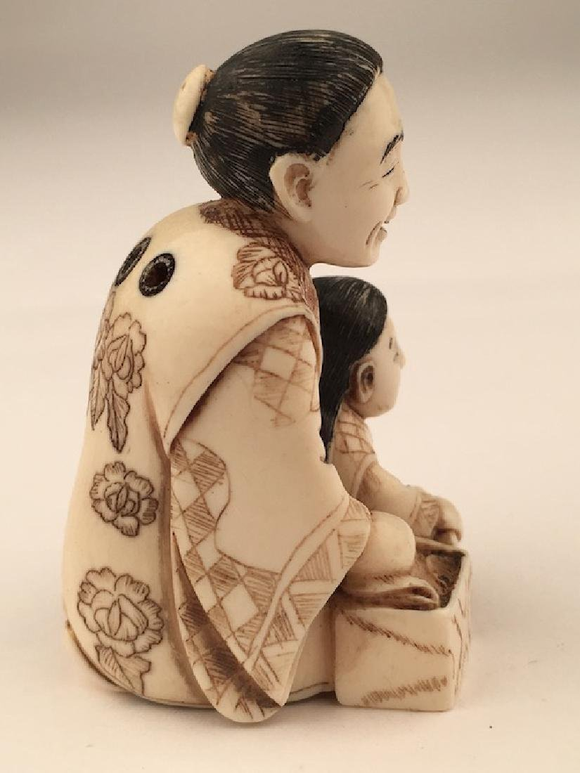 Antique carved Netsuke figure of a mother and child - 4