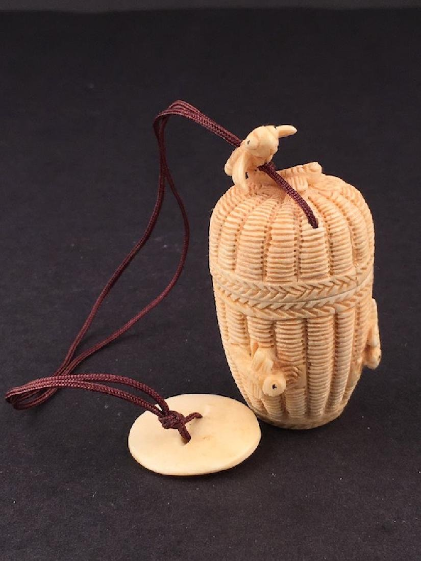 Antique carved Netsuke figure of a basket with top and