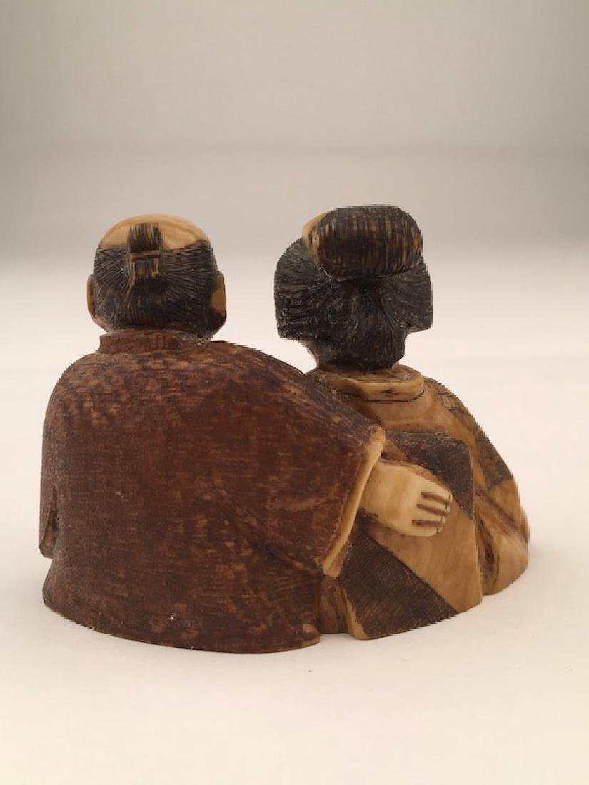 Antique carved Netsuke figure of a man and lady sitting - 3