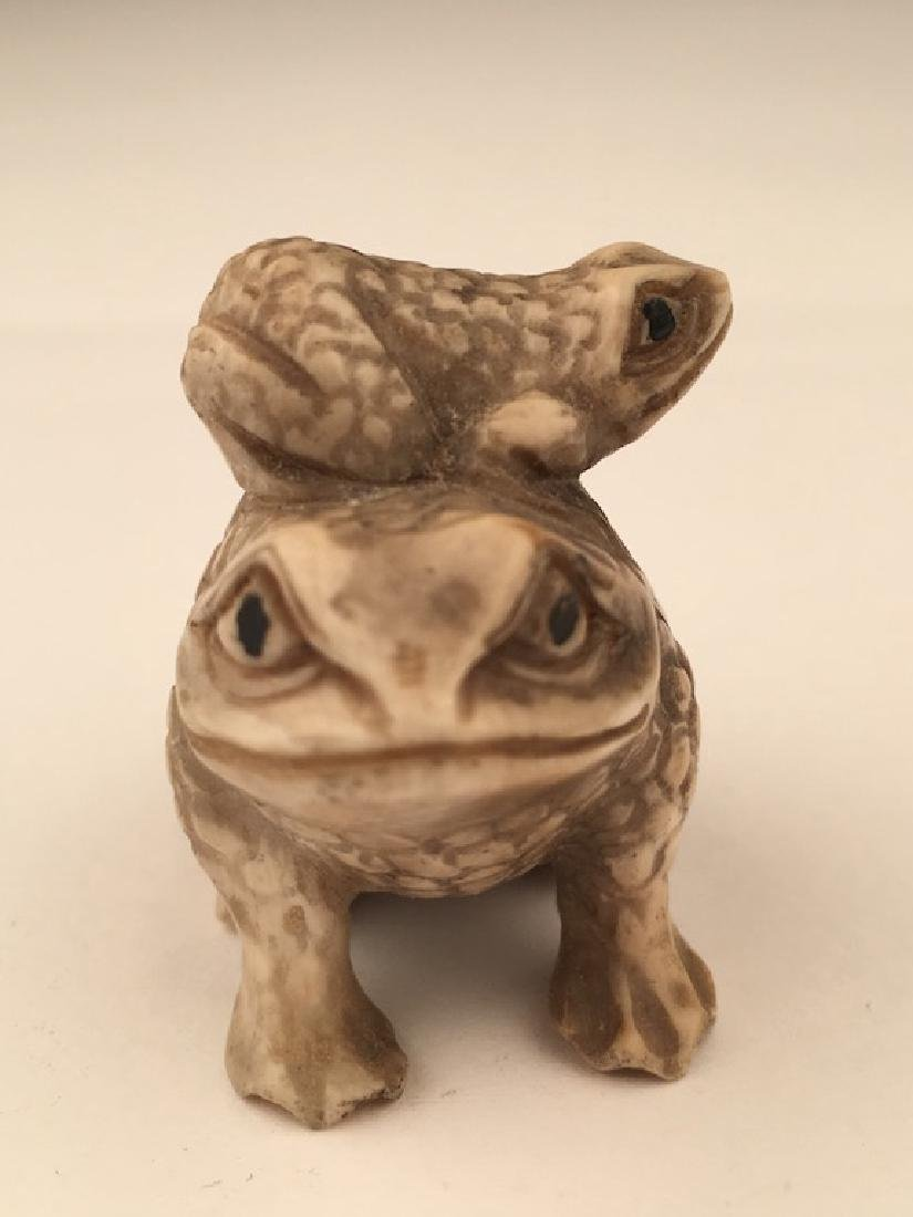 Antique carved Netsuke figure of a small frog on the