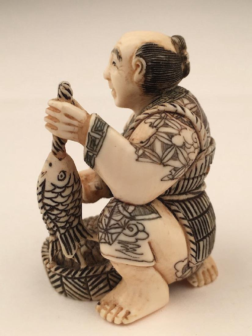 Antique carved Netsuke figure of a man with a basket of - 2