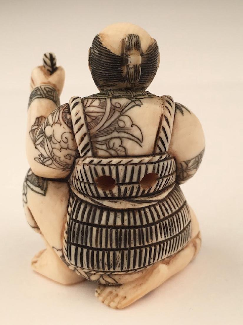Antique carved Netsuke figure of a man with a basket of - 3