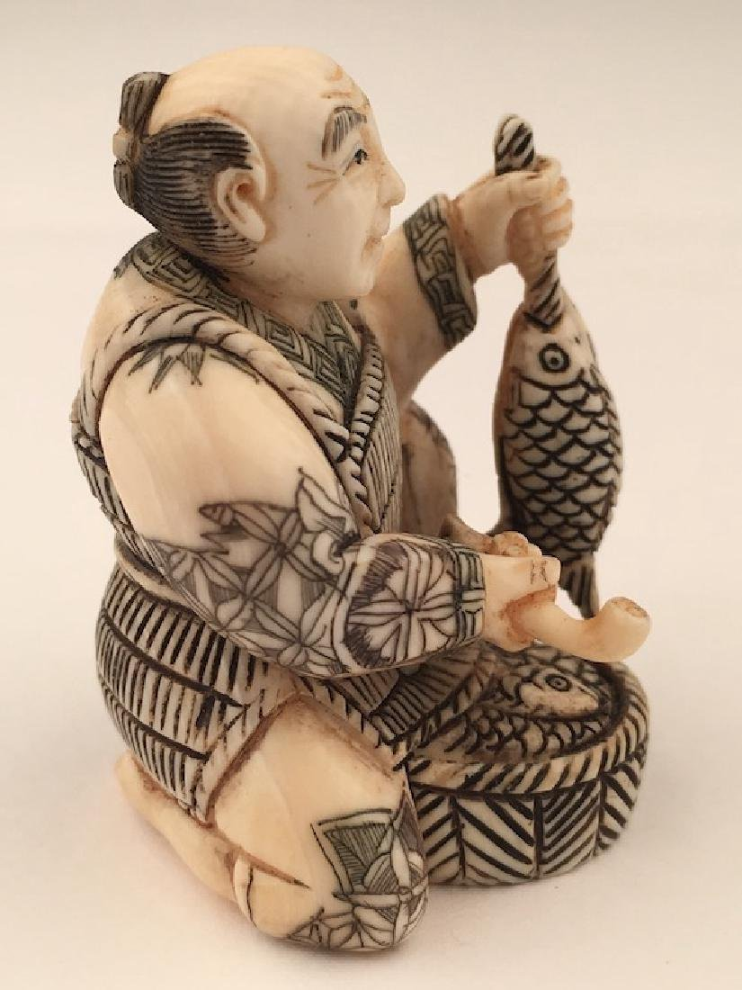 Antique carved Netsuke figure of a man with a basket of - 4
