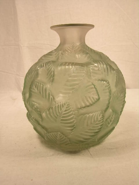 """2921: R. LALIQUE """"ORMEAUX"""" VASE WITH GREEN TINT."""