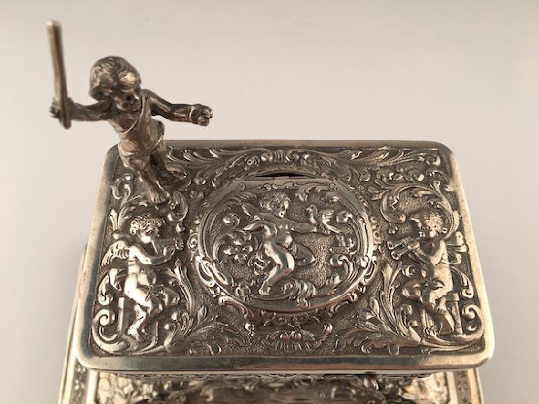 A sterling silver mechanical singing bird box with a - 4
